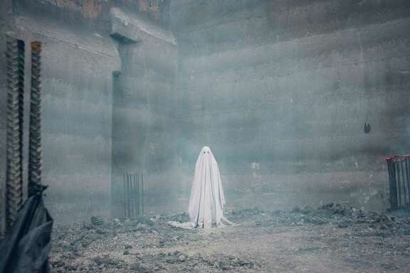 "Casey Affleck takes the form of a Charlie Brown-like ghost in ""A Ghost Story."""