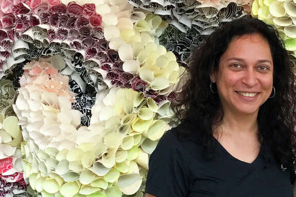 Abhidnya Ghuge uses hand-cut woodblocks to design and print paper plates by the thousands. Her exhibit is at Galveston Arts Center.