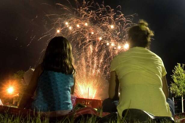 Onlookers enjoy the fireworks show immediately following the parade.  (photo by Patric Schneider)