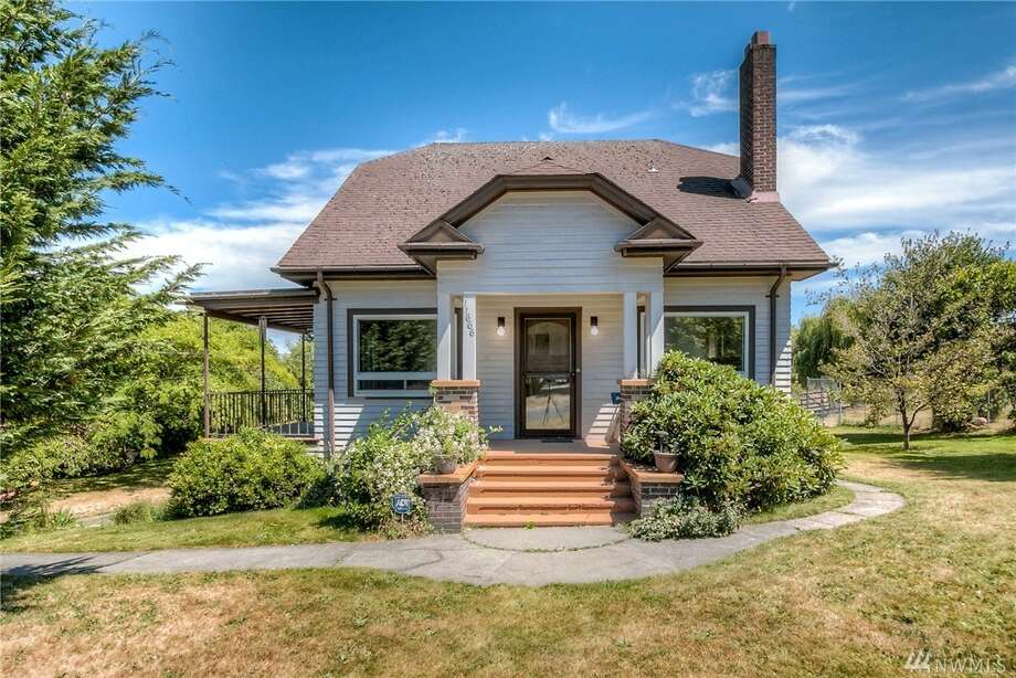 The first home, at 11666 Roseberg Ave. S., is listed for $359,950. It spans over 2,100 square feet and is in Boulevard Park in West Seattle.The three-bedroom, 1¾-bathroom home was built in 1930 and sits on a large lot with mountain views. There will be a showing for this home Sunday, July 23 from 11 a.m. to 1 p.m. You can see the full listing here. Photo: Photos By Image Arts/listing Courtesy Tracy Krueger, RE/MAX All City