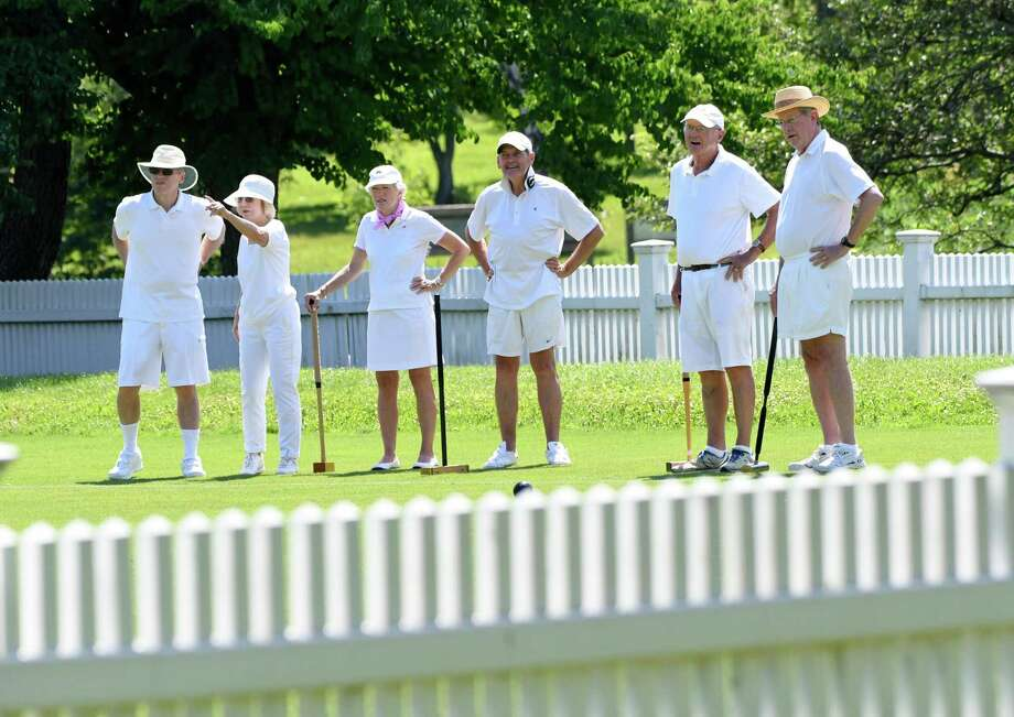 The Greenwich Croquet Club prepares to practice at the Bruce Park croquet court in Greenwich. From left are Bob and Gillian Merritt, of New Fairfield; Hilary Michaels, of Fairfield; Preston Stuart, of Greenwich; Ed Michaels, of Fairfield; and Bill Duncan, of Fairfield. Photo: Bradley E. Clift / For Hearst Connecticut Media / All images produced are owned by Bradley E. Clift  © 2017  Any use beyond Hearst Media must have written permission from copyrig