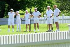 The Greenwich Croquet Club prepares to practice at the Bruce Park croquet court in Greenwich. From left are Bob and Gillian Merritt, of New Fairfield; Hilary Michaels, of Fairfield; Preston Stuart, of Greenwich; Ed Michaels, of Fairfield; and Bill Duncan, of Fairfield.