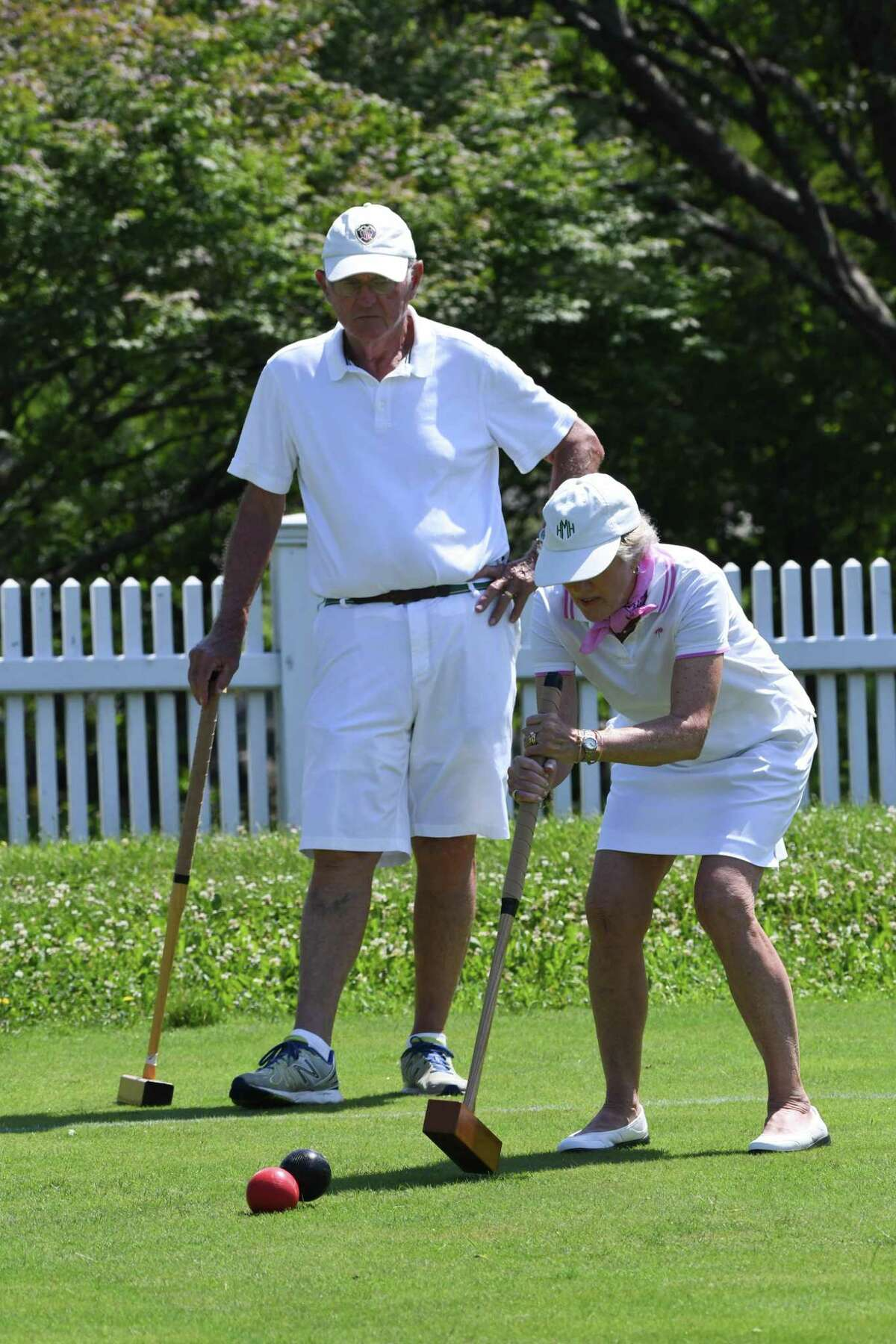 Ed Michaels, of Fairfield, watches his wife, Hilary, take a shot.