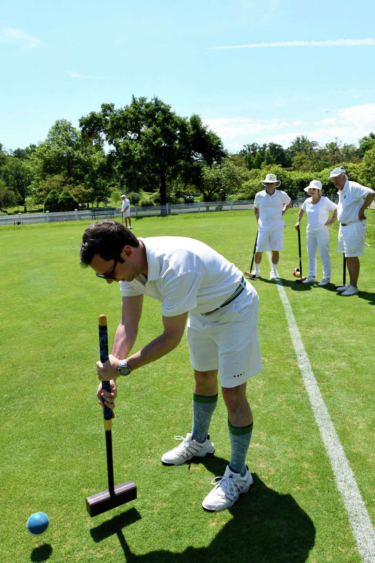 Club president Matthew Rimi launches a ball during a practice match in Greenwich recently.