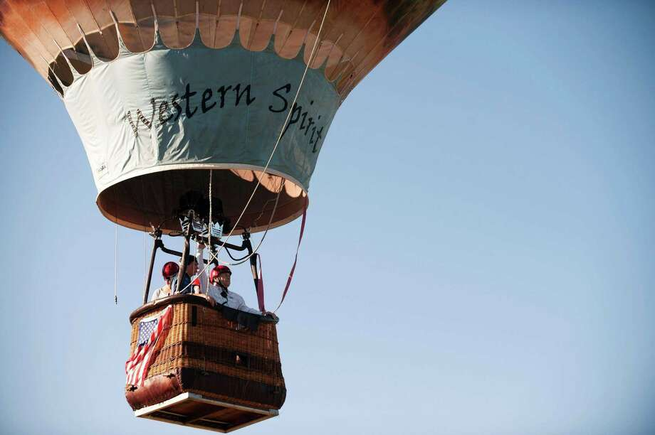 Western Spirit takes flight during the 36th Annual Hot Air Balloon Rodeo in Steamboat Springs, Colorado on July 9. Looks like fun, but now imagine a gun on board. What could go wrong? Photo: JASON CONNOLLY /AFP /Getty Images / AFP or licensors