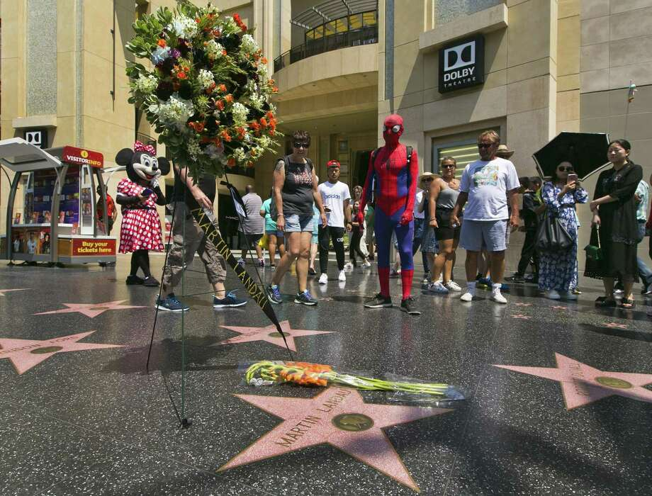 """Costumed street characters join others at a wreath in memory of actor Martin Landau at his star on the Hollywood Walk of Fame. Landaue, who won an Oscar for 's """"Ed Wood,"""" died Saturday. A reader says he is tired of """"Hollywood worship."""" Photo: Damian Dovarganes /Associated Press / Copyright 2017 The Associated Press. All rights reserved. This material may not be published, broadcast, rewritten or redistribu"""