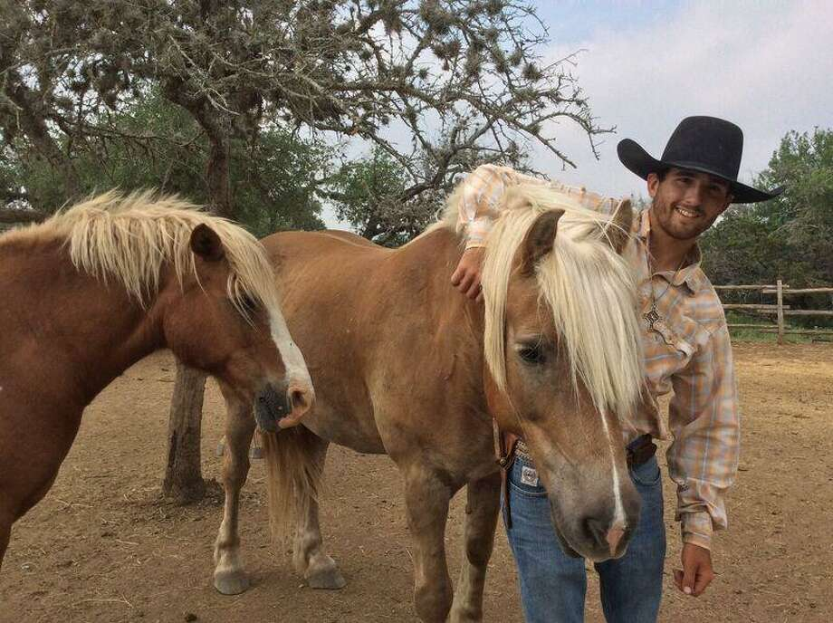 A wrangler at the Twin Elm Ranch in Bandera. Photo: By Michelle Newman / For The Express-News