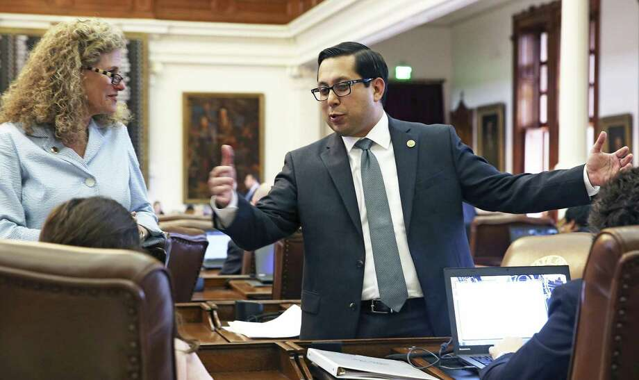 State Rep. Diego Bernal, talking here with Rep. Donna Howard, D-Austin, in May, filed a bill to put voters with disabilities or illness at the front of the voting line. But items were added that create costs for local election offices. Photo: Tom Reel /San Antonio Express-News / 2017 SAN ANTONIO EXPRESS-NEWS