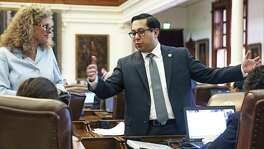 State Rep. Diego Bernal, talking here with Rep. Donna Howard, D-Austin, in May, filed a bill to put voters with disabilities or illness at the front of the voting line. But items were added that create costs for local election offices.