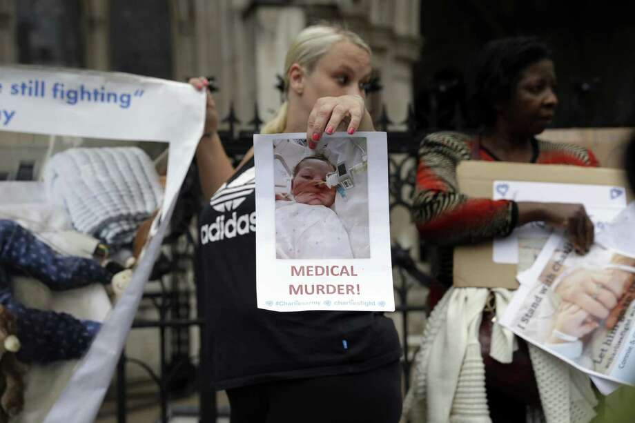 A supporter of critically ill baby Charlie Gard stands up for his parents in London on July 14. What's best for Charlie? Who is to speak for him? The most heartrending situation occurs when these two questions yield opposing answers. Photo: Matt Dunham /Associated Press / Copyright 2017 The Associated Press. All rights reserved.