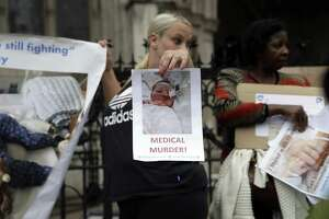 A supporter of critically ill baby Charlie Gard stands up for his parents in London on July 14. What's best for Charlie? Who is to speak for him? The most heartrending situation occurs when these two questions yield opposing answers.