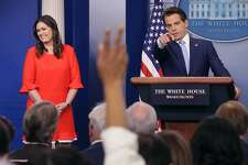 WASHINGTON, DC - JULY 21:  White House Principal Deputy Press Secretary Sarah Huckabee Sanders (L) and Anthony Scaramucci conduct the daily White House press briefing in the Brady Press Briefing Room at the White House July 21, 2017 in Washington, DC. White House Press Secretary Sean Spicer quit after it was announced that Trump hired Scaramucci, a Wall Street financier and longtime supporter, to the position of White House communications director.  (Photo by Chip Somodevilla/Getty Images) *** BESTPIX ***