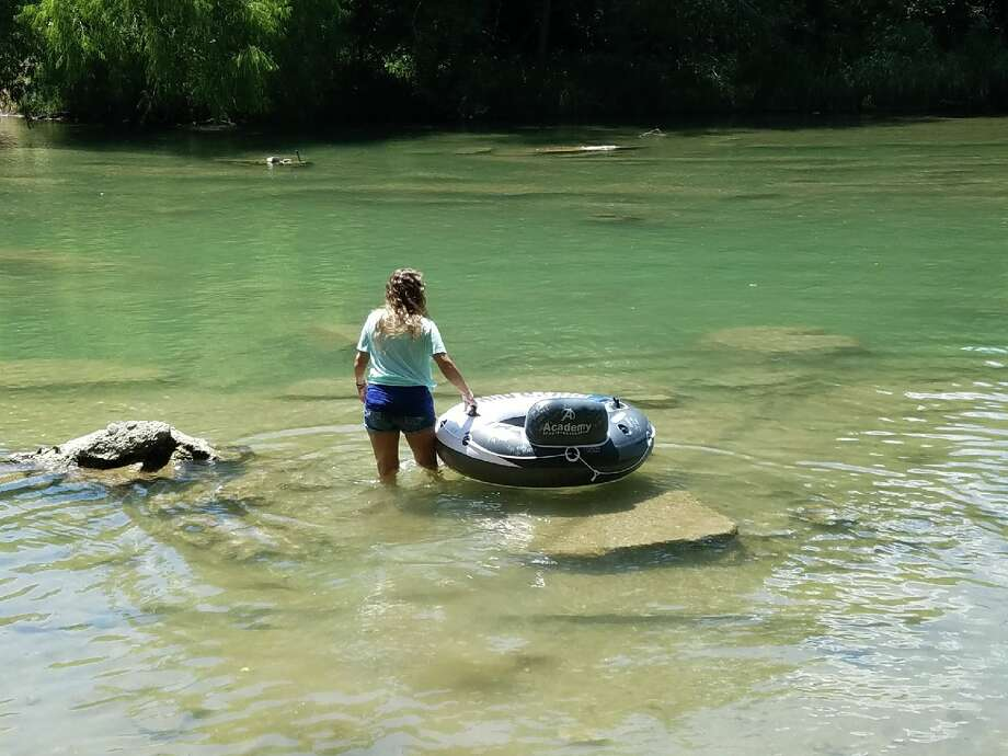 Tracey Corum, from Bellville, memorialized her late son, Justin Hernandez, by releasing a tube on the Guadalupe River in his honor. Photo: Courtesy, Tracy Corum