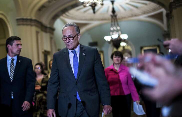 Senate Minority Leader Chuck Schumer prepares to address questions regarding the failed Senate Republican health care bill. A reader says it is up to the Democrats to help craft acceptable legislation.