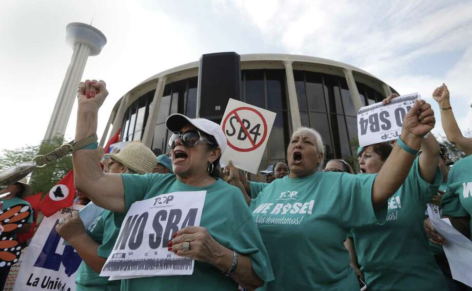 "Lydia Balderas, left, and Merced Leyua, right, join others as they protest outside the Federal Courthouse to oppose a new Texas ""sanctuary cities"" bill that aligns with the president's tougher stance on illegal immigration on June 26. Opposing this bill isn't a matter of flouting the law, but embracing it. Photo: Eric Gay /Associated Press / Copyright 2017 The Associated Press. All rights reserved."