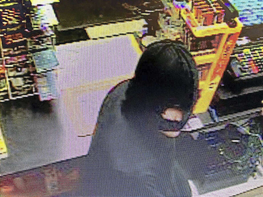 (Photo courtesy of the North Haven Police Department)North Haven police are looking for an armed, masked man who allegedly robbed the Shell gas station at 195 State St. late Tuesday. Photo: Digital First Media