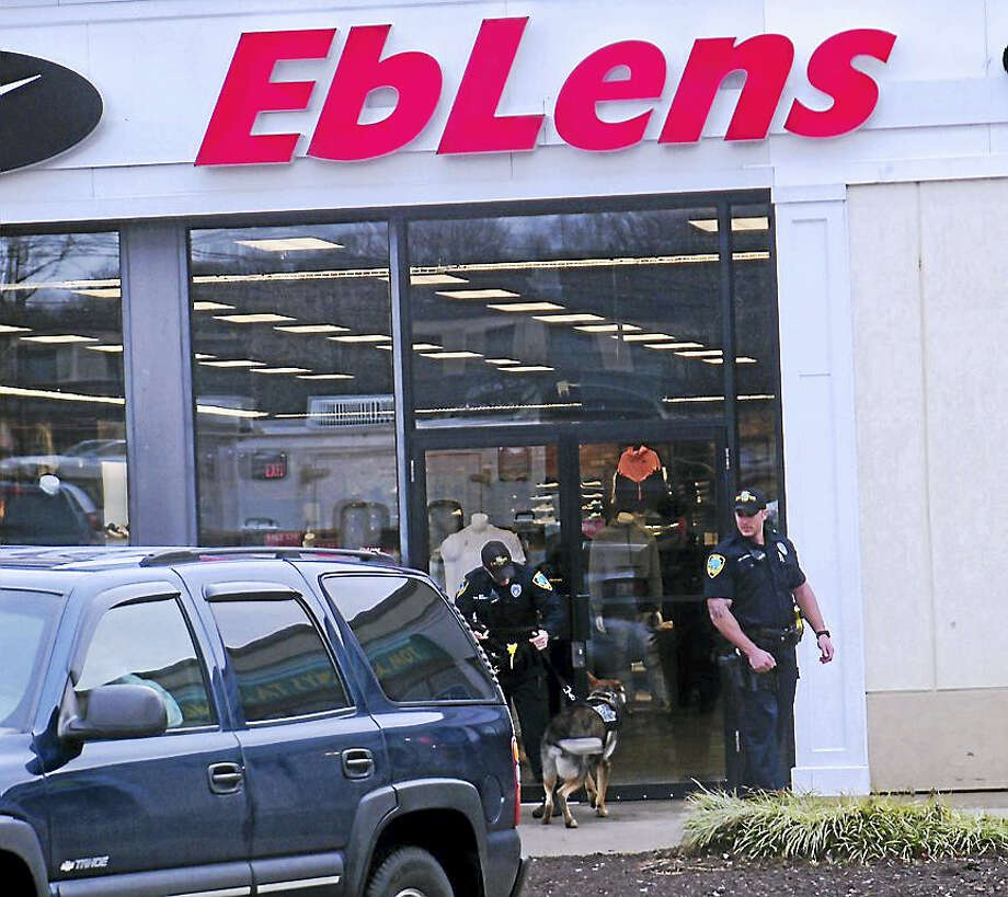 (Wes Duplantier/New Haven Register) East Haven police were investigating Tuesday after someone robbed the EbLens clothing store on Foxon Road. It was not immediately clear what was taken from the store. Photo: Digital First Media