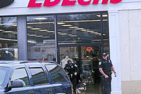 (Wes Duplantier/New Haven Register) East Haven police were investigating Tuesday after someone robbed the EbLens clothing store on Foxon Road. It was not immediately clear what was taken from the store.