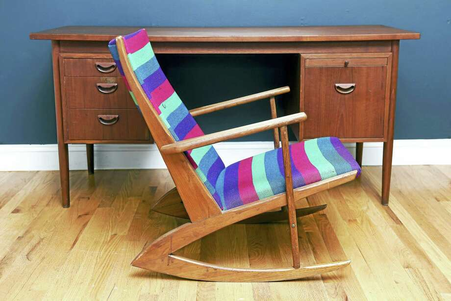 (Arnold Gold-New Haven Register)  A Danish modern teak rocking chair with the original fabric by Georg Jensen at CT Modern on Main St. in Branford on 1/13/2017. Photo: Digital First Media