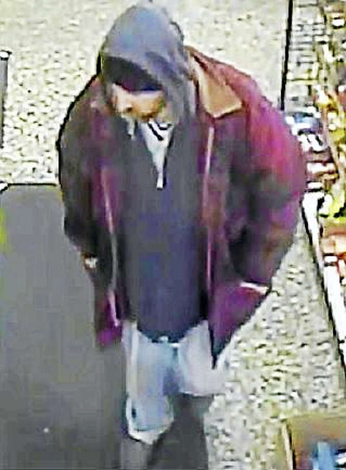 (Photo courtesy of the West Haven Police Department)Police are asking the public to help them find the man in the red jacket who allegedly pushed a clerk Wednesday night during a robbery at Krauszer's, 111 Elm St. The clerk suffered a minor hand injury. Photo: Digital First Media