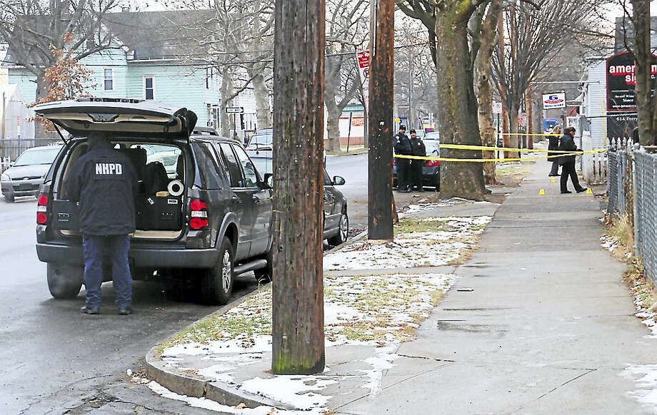 (Wes Duplantier/New Haven Register) New Haven police were investigating Tuesday after someone was shot on Ferry Street near Fox Street. Investigators were looking for a black crossover style vehicle that was seen in the area. Photo: Digital First Media