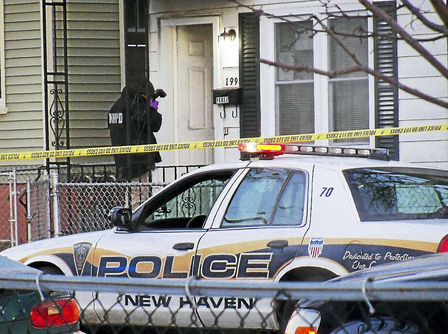 (Wes Duplantier/The New Haven Register)New Haven police were investigating Monday after a man was shot at home at 199 Pine St. The homeowner reportedly told police the man had kicked in the door before he shot the man. Photo: Digital First Media