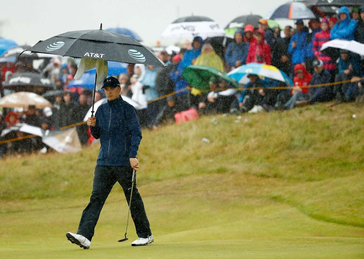 SOUTHPORT, ENGLAND - JULY 21: Jordan Spieth of the United States under an umbrella on the 7th green during the second round of the 146th Open Championship at Royal Birkdale on July 21, 2017 in Southport, England. (Photo by Gregory Shamus/Getty Images)