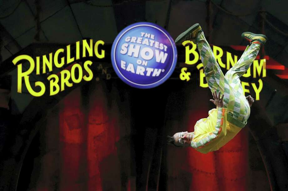 """A Ringling Bros. and Barnum & Bailey clown does a somersault during a performance Saturday, Jan. 14, 2017, in Orlando, Fla. The Ringling Bros. and Barnum & Bailey Circus will end the """"The Greatest Show on Earth"""" in May, following a 146-year run of performances. Kenneth Feld, the chairman and CEO of Feld Entertainment, which owns the circus, told The Associated Press, declining attendance combined with high operating costs are among the reasons for closing. (AP Photo/Chris O'Meara) Photo: AP / Copyright 2017 The Associated Press. All rights reserved."""