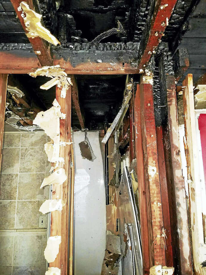 (Photo courtesy of the Hamden Fire Department) Local firefighters chased down a fire Friday morning in the walls of a home at 28 Lynmot Road in Hamden. No was hurt inthe fire, which was first reported in a bathroom fan. Photo: Digital First Media