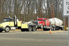 (Wes Duplantier/The New Haven Register)The northbound Exit 55 on-ramp and off-ramp from Interstate 95 in Branford were shut down for hours Thursday after a tanker truck rolled over and crashed. No one was hurt in the accident.