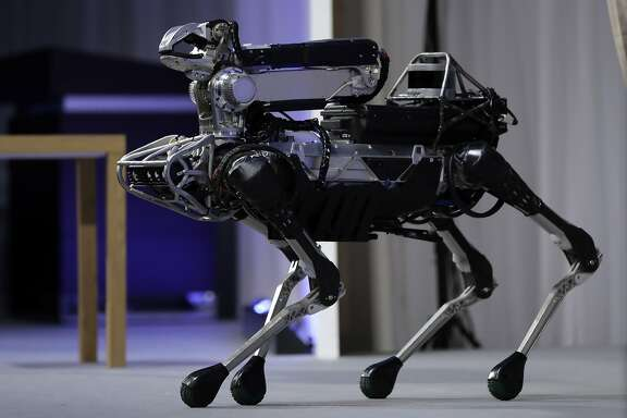 Boston Dynamics Inc.'s SpotMini robot is demonstrated at SoftBank World 2017 event in Tokyo, Japan, on Thursday, July 20, 2017. SoftBank World will run through July 21. Photographer: Kiyoshi Ota/Bloomberg