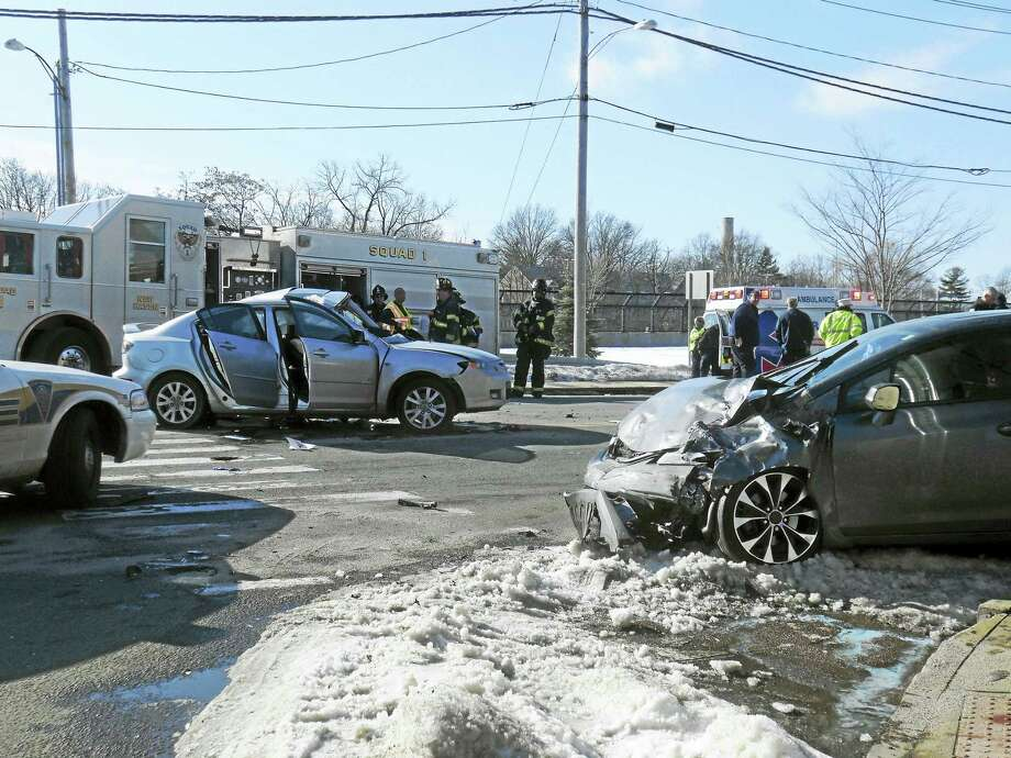 (Wes Duplantier -- New Haven Register) A man died and two other people were hurt in a serious three-vehicle crash late Thursday morning at the intersection of Townsend and Forbes avenues in New Haven. The intersection was shut down for hours after the accident as police investigated. Photo: Journal Register Co.
