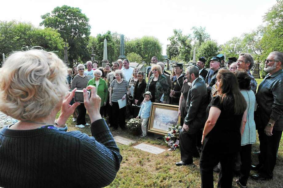 (Photo by Peter Hvizdak — Register)Pamela Baldini of Suffield Conn., the great great grandaughter of of Civil War veteran Joseph Lafo, takes a photography of Lafo's descendants at Lafo's grave at St. Bernard Cemetery in New Haven, after a dedication ceremony of a  grave marker for him Saturday September 14, 2013. With the descendants  are 14th Connecticut Co. G.  Civil War re-enactors Photo: New Haven Register / ©Peter Hvizdak /  New Haven Register