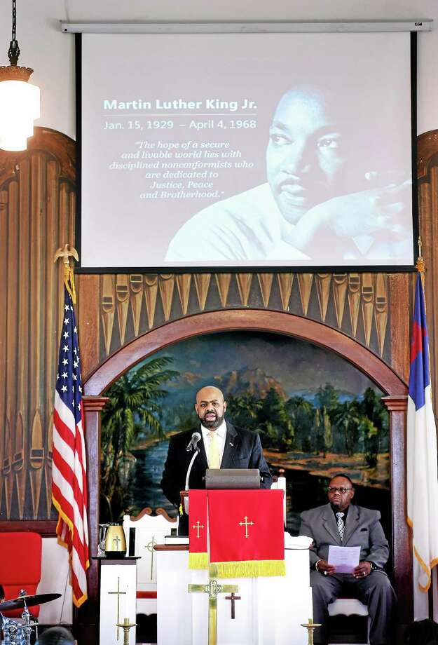 (Arnold Gold-New Haven Register)  Attorney Michael Jefferson delivers the Statement of Purpose at Shiloh Missionary Baptist Church after the 45th Annual Dr. Martin Luther King Jr. Love March in New Haven on 1/15/2015. Photo: Journal Register Co.