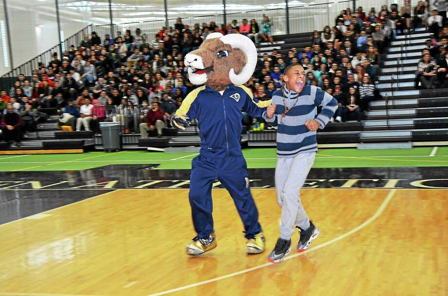 Rampage, the mascot for the St. Louis Rams, with students at the stay in school rally Thursday. The rally took place at the Floyd Little Athletic Center in New Haven as part of the Walter Camp All American team weekend. Contributed photo Photo: Journal Register Co.