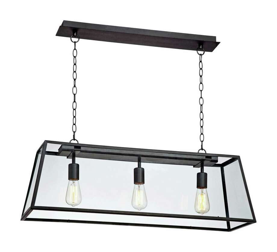This photo provided by Lampsplus.com shows a black frame and Edison bulbs make for a sophisticated, industrial-style chandelier, great over an island. (Lampsplus.com via AP) Photo: AP / Lampsplus.com