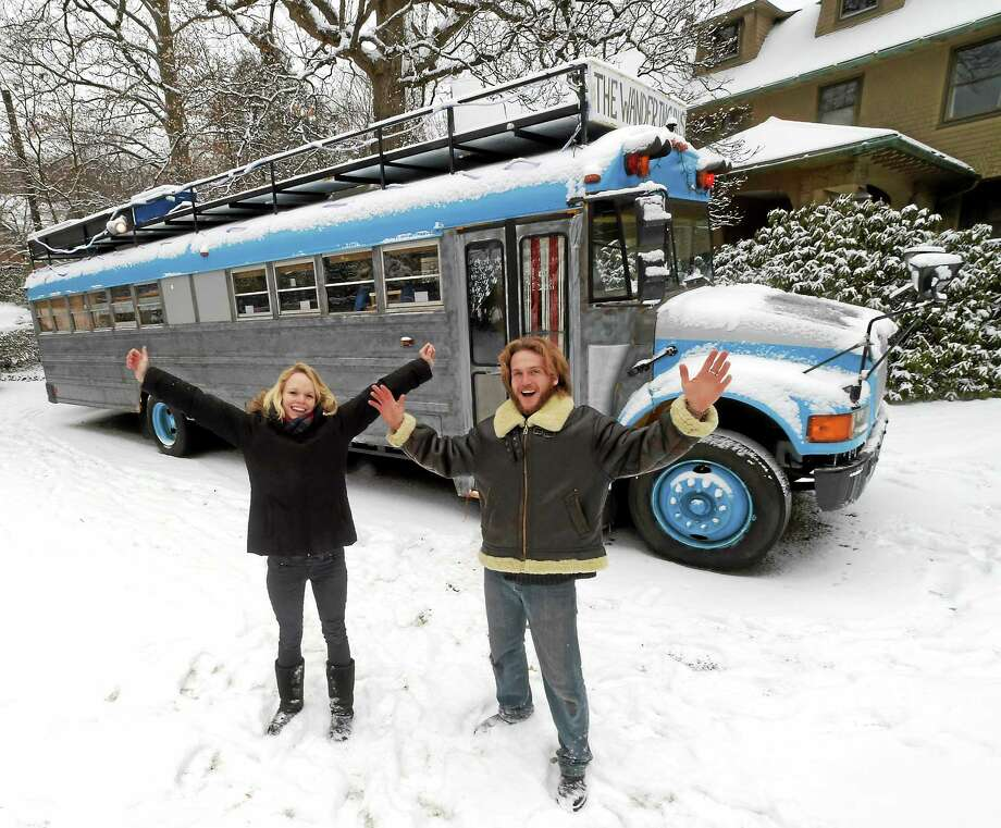 "(Peter Hvizdak - New Haven Register) Chauncey Carter and Sarah Jane McCrohan are planning to roam the U.S. in their vehicle, ""The Wandering Bus"", a reconverted school bus. Photo: ©2015 Peter Hvizdak / ©2015 Peter Hvizdak"
