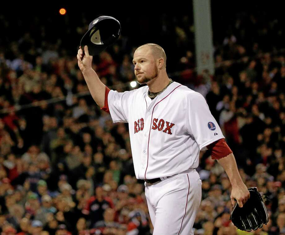 Boston Red Sox starting pitcher Jon Lester acknowledges the crowd as he leaves the game during the eighth inning of Game 1 of baseball's World Series against the St. Louis Cardinals Wednesday, Oct. 23, 2013, in Boston. (AP Photo/David J. Phillip) Photo: AP / AP