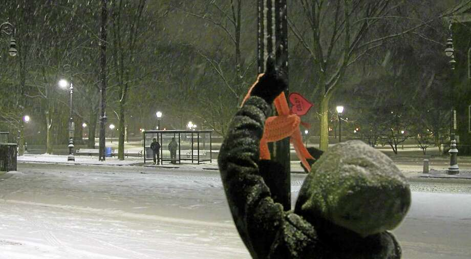 (Contributed photo)  As United Way of Greater New Haven kicked off Neighbor to Neighbor, Tuesday night people set out with scarves and wrapped them around poles and posts in the area. Photo: Digital First Media