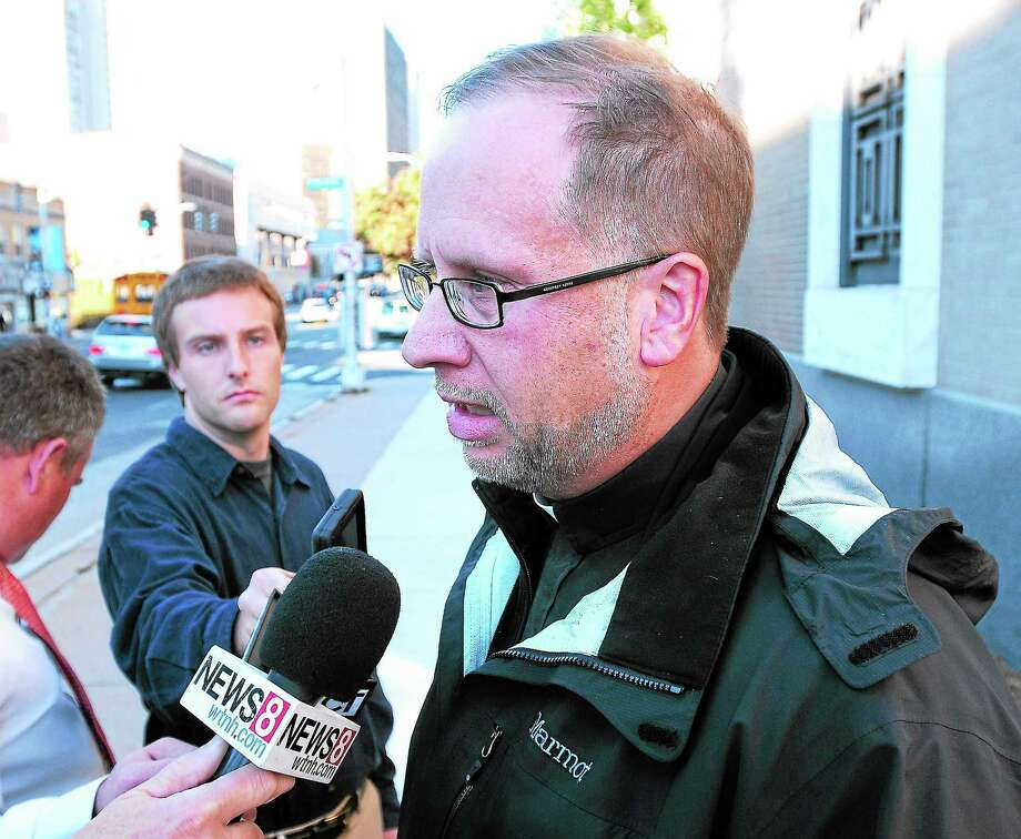 (Arnold Gold — New Haven Register)  Father James Manship speaks with the press outside of the United States Courthouse in Hartford after guilty verdicts were announced for former East Haven Police Officers Dennis Spaulding and David Cari on 10/21/2013. Photo: Journal Register Co.