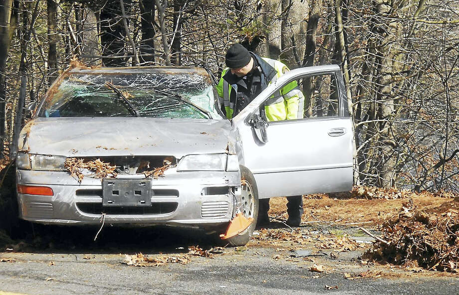 (Wes Duplantier -- New Haven Register) Part of Mather Street in Hamden was shut down from about an hour Friday morning after rescue crews discovered a car that had crashed down embankment sometime before. No injuries were reported. Photo: Journal Register Co.