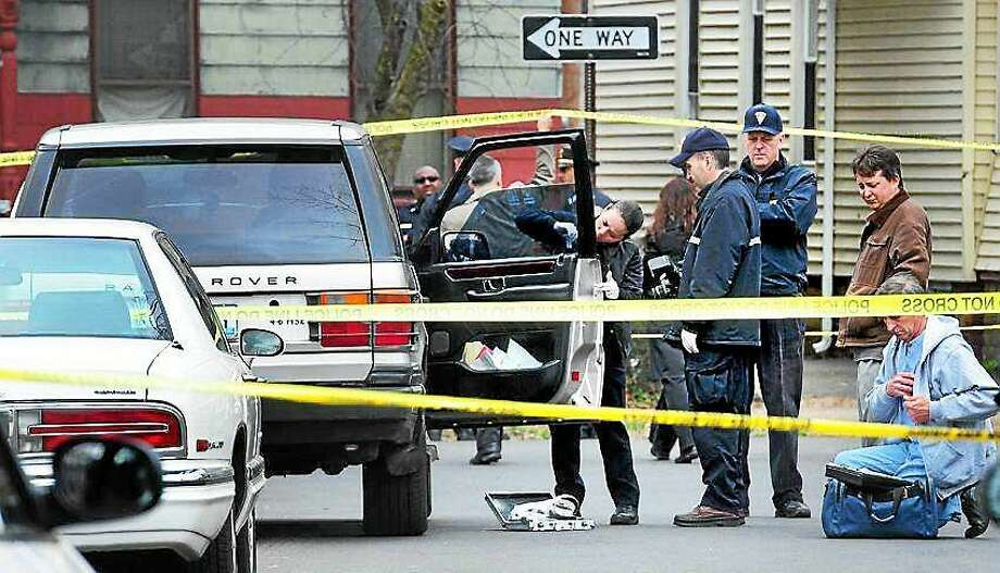 """New Haven police investigate the shooting death of Thomas """"T.J."""" L. Mozell Jr. at the corner of County and Munson streets on March 17, 2012. Almost exactly three years after the shooting, police said they have charged Vincent """"Guns"""" Ayala in connection with the killing. Photo: (Arnold Gold-- New Haven Register File Photo)"""