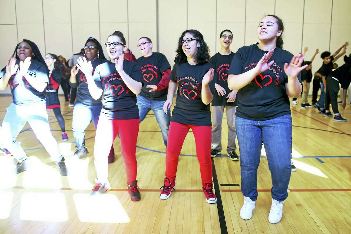 (Arnold Gold-New Haven Register) Eighth graders from the Celentano Biotech Health and Medical Magnet School in New Haven participate in a zumba session at the second annual Go Red for a Healthy Heart event on 2/26/2016.