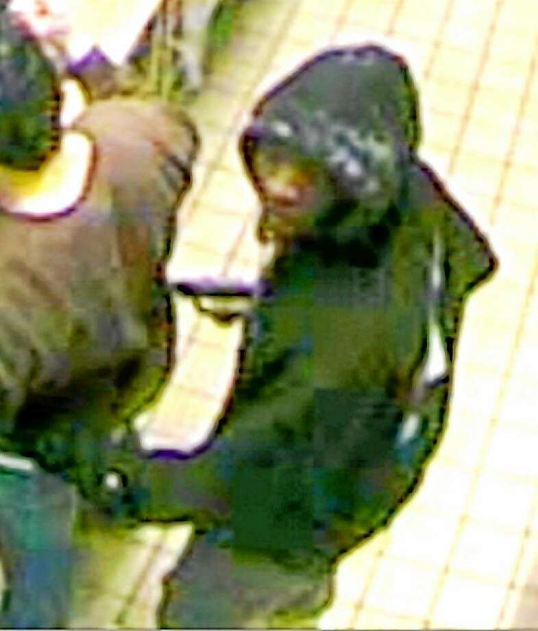 Courtesy photo. West Haven police are looking for two males who allegedly robbed a Dunkiní Donuts on Derby Avenue on Monday. One of the suspects wore a hooded sweatshirt and brandished a weapon and the other wore a mask, police said. Photo: Journal Register Co.