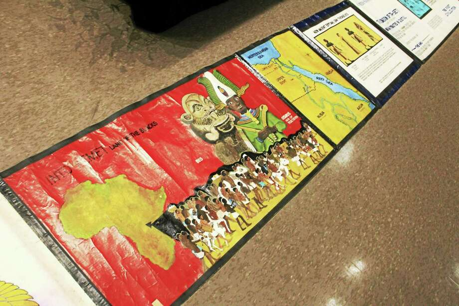 A close up of the elongated mural depicting the history of civilization and its African roots created by artist Nelson Ford, which was on display at Augusta Lewis Troup School in New Haven on Wednesday, Feb. 24. Esteban L. Hernandez New Haven Register Photo: Journal Register Co.