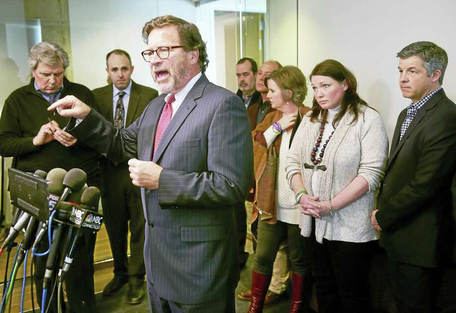 (Arnold Gold-New Haven Register)  Bill Sherlach (left) addresses the media at a press conference at the law offices of of Koskoff Koskoff & Bieder in Bridgeport on 2/22/2016 prior to a hearing to determine wether the manufacturer of the AR-15 rifle will face a trial for the deaths at Sandy Hook Elementary School in 2012.  Sherlach's wife, school psychologist Mary Sherlach, was killed in the mass shooting. At right are family members of others who were killed. Photo: Journal Register Co.