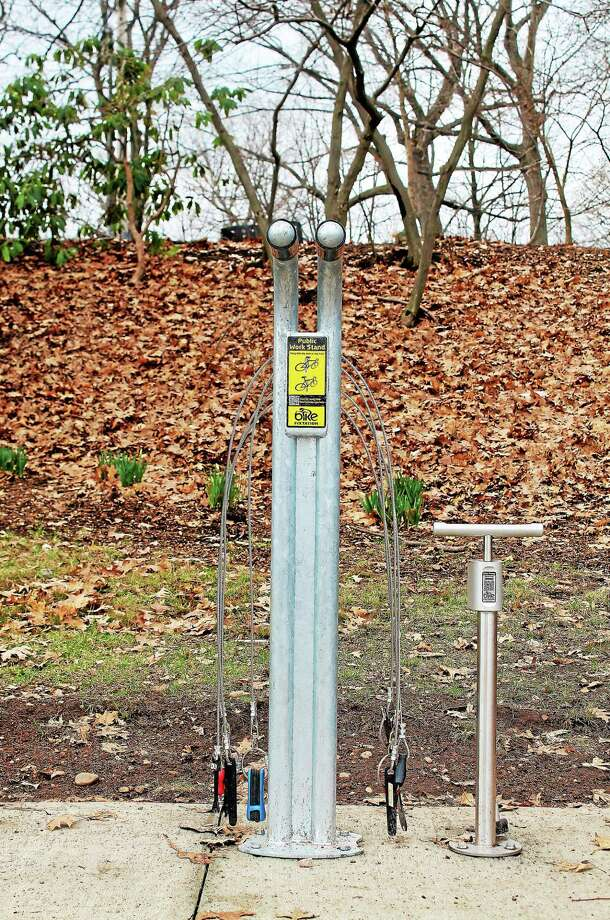 Several new self-help bicycle maintenance stations have popped up around the city in recent weeks, including this one in East Rock Park. (Evan Lips - New Haven Register) Photo: Journal Register Co.