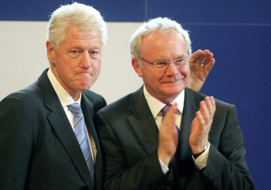 In this Sept. 29, 2010 photo, Northern Ireland's Deputy First Minister Martin McGuinness, right,  is accompanied by former U.S. President Bill Clinton after speaking at the University of Ulster, Magee campus, in Londonderry. McGuinness, the Irish Republican Army warlord who led his underground, paramilitary movement toward reconciliation with Britain, and was Northern Ireland's deputy first minister for a decade in a power-sharing government, has died, his Sinn Fein party announced Tuesday, March 21, 2017,  on Twitter. He was 66. (Paul Faith/PA via AP) Photo: AP / PA