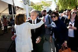 California Governor Jerry Brown gets a hug from Minority  House Leader Nancy Pelosi as California Representative Anna Eshoo looks on during a groundbreaking ceremony and event for Caltrain's electrification and modernization project, at the Caltrain Station in Millbrae, CA, on Friday July 21, 2017.