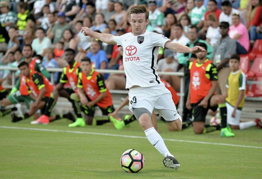 San Antonio FC defender Greg Cochrane prepares to strike a cross during the 2017 United Soccer League season at Toyota Field. Photo: Darren Abate, STF / USL / Darren Abate Media LLC